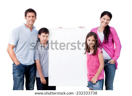 Portrait of happy family holding blank banner isolated over white background - stock photo