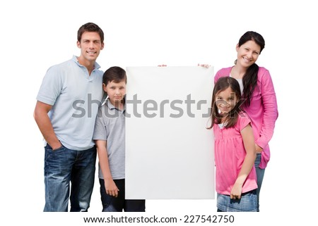 Portrait of happy family holding blank billboard isolated over white background