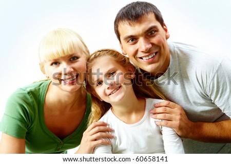Portrait of happy family in casual clothes looking at camera
