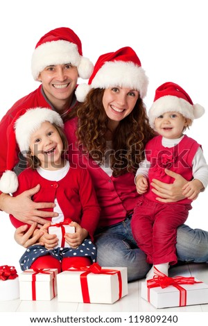 Portrait of happy family in Christmas hat on white background - stock photo