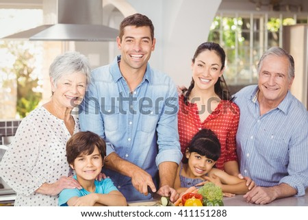 Portrait of happy family in kitchen at home - stock photo