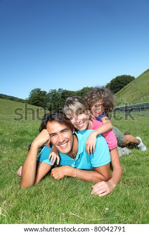 Portrait of happy family in summer vacation - stock photo