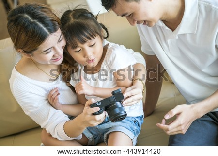 portrait of happy family look at the camera and smiling at home - stock photo