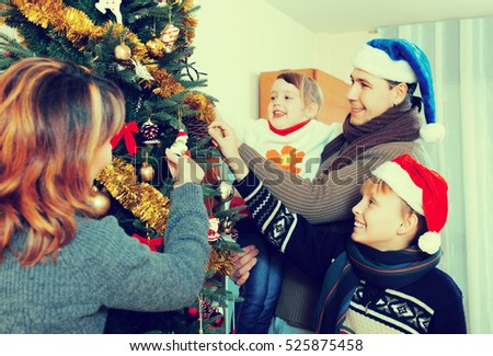 Portrait of Happy family of four celebrating Christmas