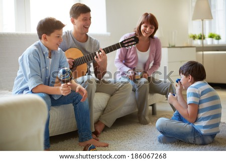Portrait of happy family of four having fun at leisure - stock photo