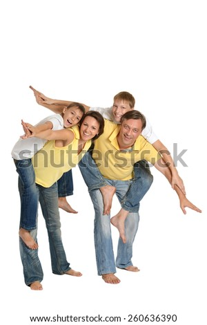 portrait of happy family of four in full length on a white background - stock photo