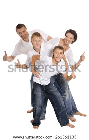 Portrait of happy family of four on a white background