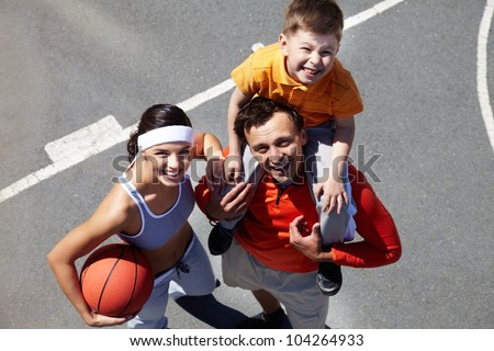 Portrait of happy family on playground