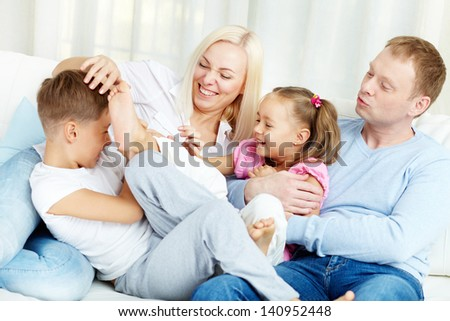 Portrait of happy family playing and laughing