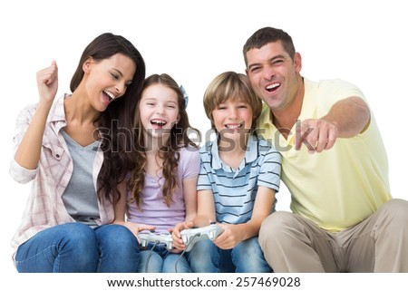 Portrait of happy family playing video game over white background