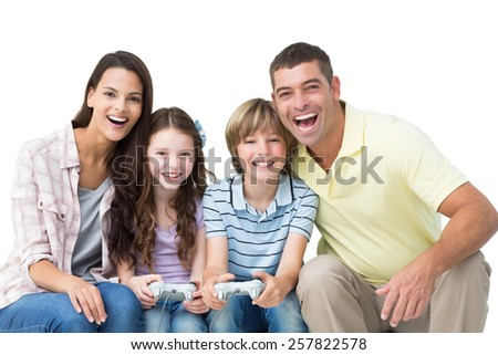 Portrait of happy family playing video game together over white background - stock photo
