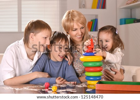 portrait of happy family relaxing at home
