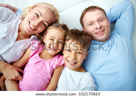 Portrait of happy family resting at home