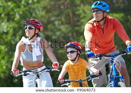 Portrait of happy family riding on bicycles at leisure