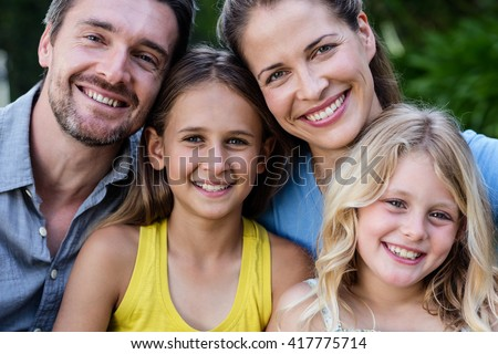 Portrait of happy family smiling - stock photo