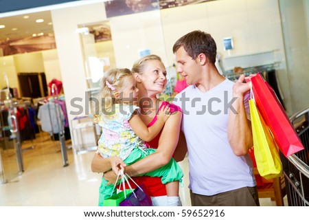 Portrait of happy family spending free time in department store - stock photo
