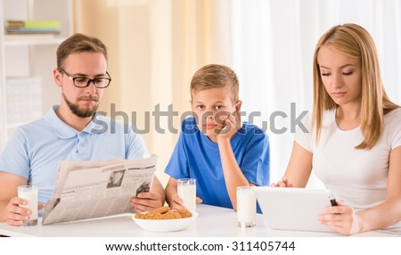 Portrait of happy family while they are having breakfast together. - stock photo