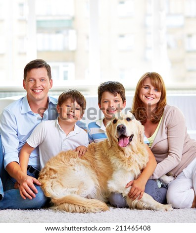 Portrait of happy family with a dog - stock photo