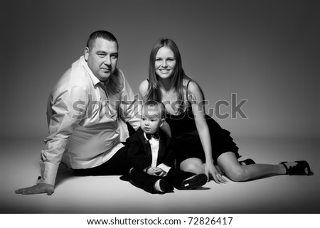 Portrait of happy Family with child. Studio shot.