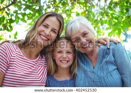 Portrait of happy family with granny standing outdoors - stock photo