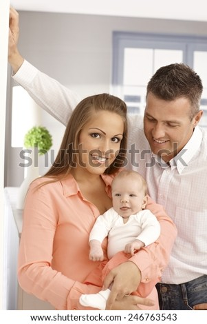 Portrait of happy family with newborn baby.