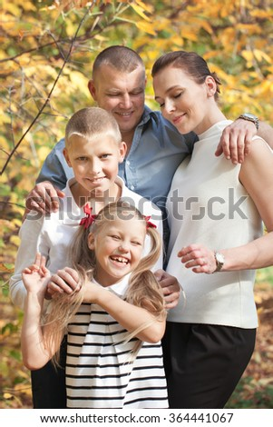 Portrait of happy family with two children, outdoor