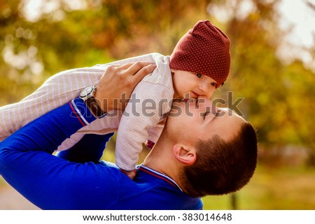 Portrait of happy father and baby in the park.Family child outdoors caucasian - stock photo