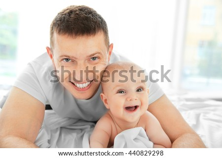 Portrait of happy father and cute baby - stock photo
