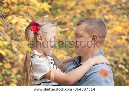 Portrait of happy father and daughter outdoor. - stock photo