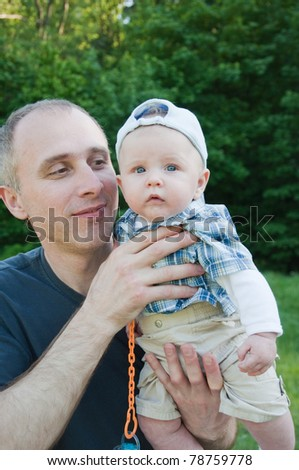 portrait of happy father and son in the park - stock photo