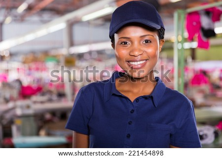 portrait of happy female clothing factory worker - stock photo