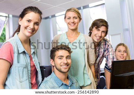 Portrait of happy female computer teacher and students in her class - stock photo