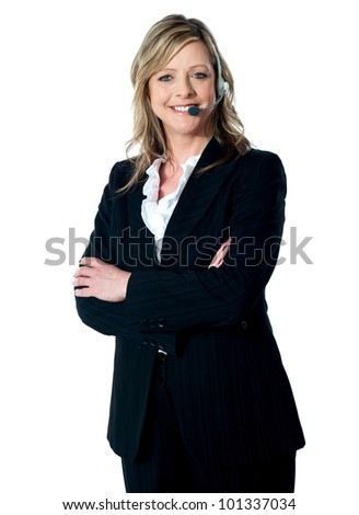 Portrait of happy female customer service executive with arms crossed, smiling at camera - stock photo