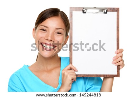 Portrait of happy female doctor holding blank paper on clipboard isolated over white background - stock photo