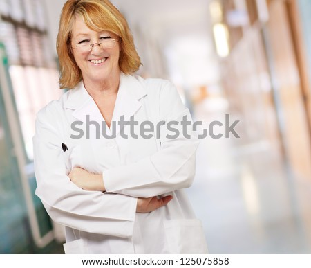 portrait of happy female doctor, indoor - stock photo