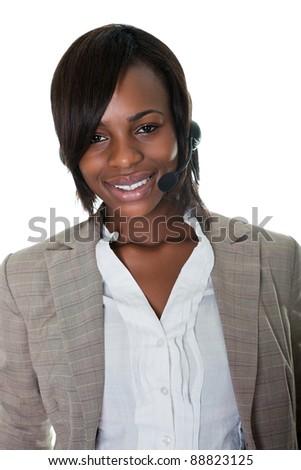 Portrait of happy female executive wearing headset on white background - stock photo