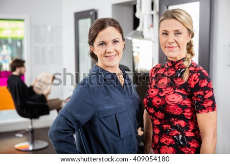 Portrait Of Happy Female Hairdressers In Salon - stock photo