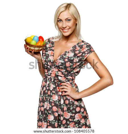 Portrait of happy female holding basket with Easter eggs, isolated on white background - stock photo