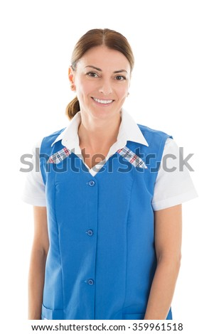 Portrait of happy female janitor standing against white background - stock photo