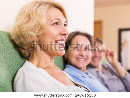 Portrait of happy female pensioners at home - stock photo