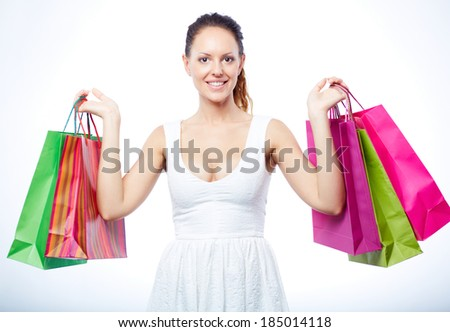 Portrait of happy female satisfied with her lucky shopping over white background