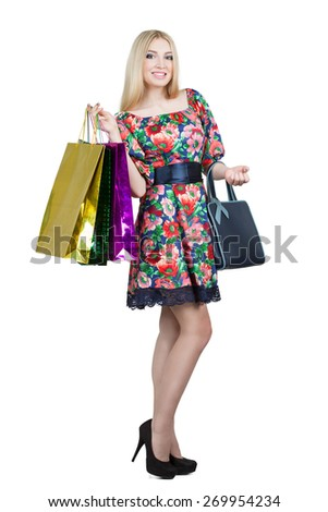 Portrait of happy female shopaholic with several paper bags  - stock photo