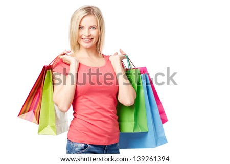Portrait of happy female with colorful paperbags over white background