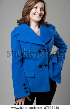 Portrait of happy forty years old woman in studio - stock photo