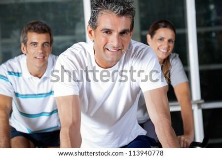 Portrait of happy friends in health club - stock photo