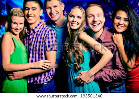 Portrait of happy friends looking at camera at party  - stock photo