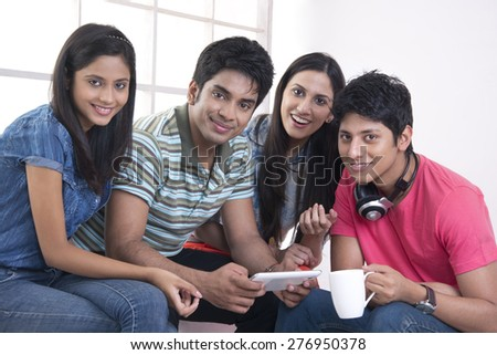 Portrait of happy friends spending leisure time in college - stock photo