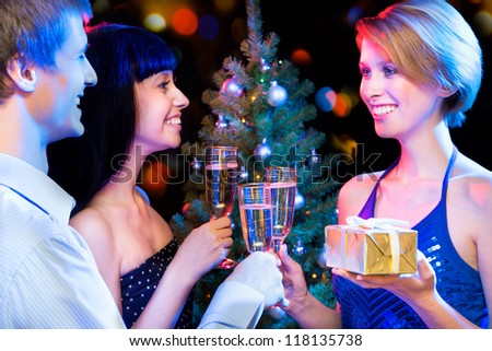 Portrait of happy friends wishing you Merry Christmas - stock photo
