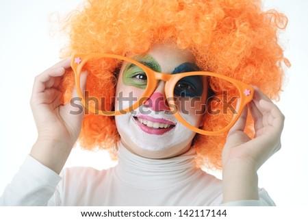 Portrait of happy funny clown girl - stock photo