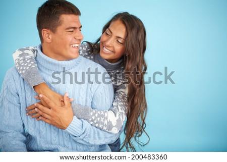 Portrait of happy girl embracing her boyfriend - stock photo